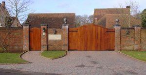 Iroko hardwood gate with matching pedestrian gate